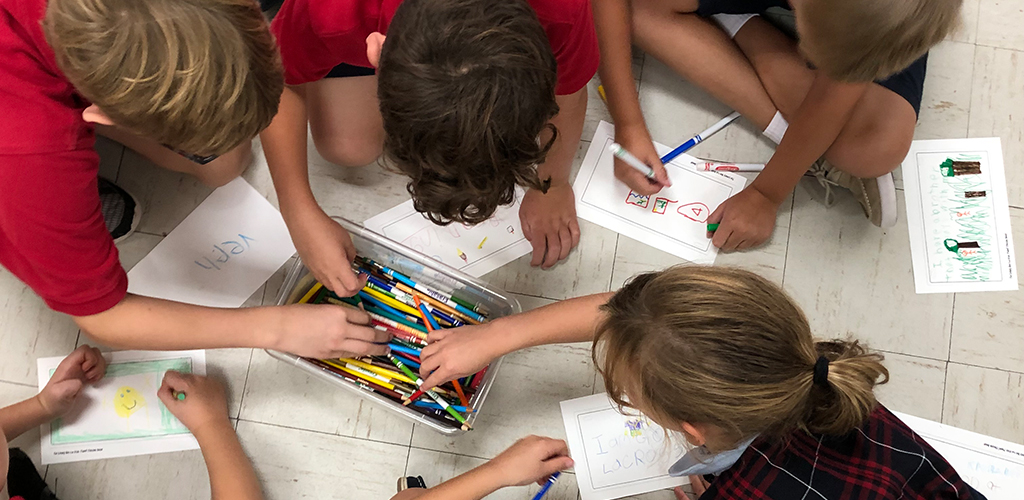 Kids Drawing Together at School